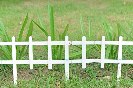 Wooden fence in garden Stock Photo