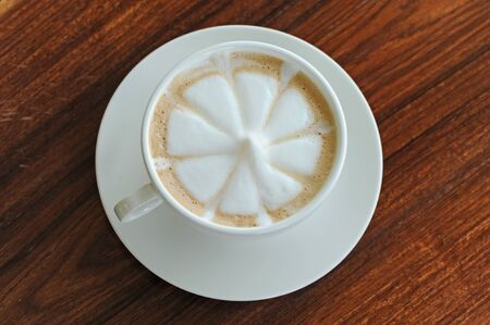 Flower drawing on latte art coffee photo