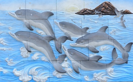 Dolphin tile on wall Editorial