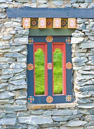 Bhutanese window in the stone wall  Stock Photo - 12392980