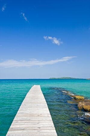 Wooden footbridge along the beach of Kut island, Thailand  photo