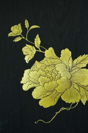 Golden flower painting on wood Stock Photo