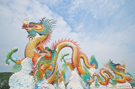 Chinese style dragon statue with blue sky Stock Photo