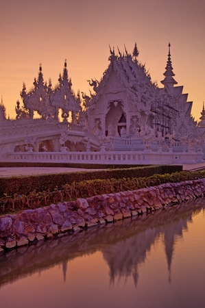 Wat Rongkun at sunset - the white temple in Chiangrai , Thailand  Stock Photo - 13428223