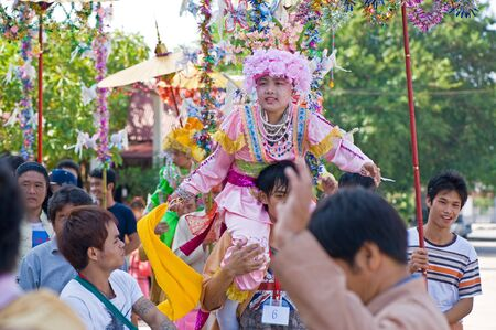 SAMUTSAKORN, THAILAND-APRIL 8  Poi Sang Long festival, a ceremony where boys become novice monk, during in parade around township on April 8, 2012 in Samutsakorn, Thailand