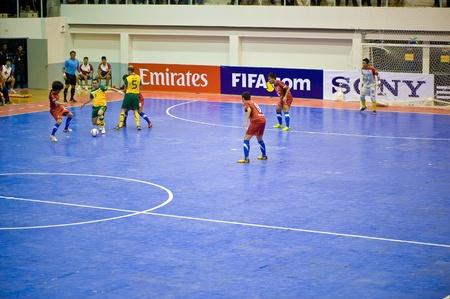 SUPHANBURI - MAY 18 : Thailand vs Australia, Friendly Match, Players into the ball on MAY 18, 2012 in Suphanburi, Thailand.