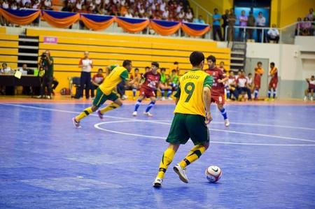 SUPHANBURI - MAY 18 : Thailand vs Australia, Friendly Match, Australian players offense on MAY 18, 2012 in Suphanburi, Thailand. Editorial