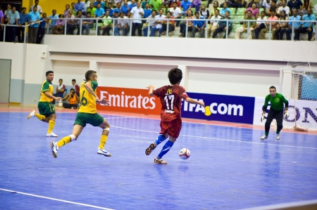 SUPHANBURI - MAY 18 : Thailand vs Australia, Friendly Match, Thai players offense on MAY 18, 2012 in Suphanburi, Thailand.