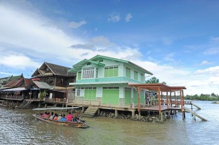 boatman: Old water town at Amphawa, Thailand