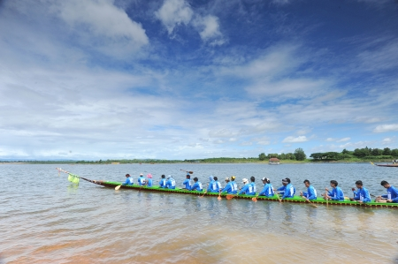 RATCHABURI,THAILAND - SEPT 3  Traditional Thai Long Boat with a crew of 30 waiting time for match during Queen Cup Traditional Long Boat Race Championship on Sept  3, 2011 in Ratchaburi, Thailand