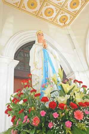 sacred heart: Statues of Holy Women in Roman Catholic Church with flower, Thailand