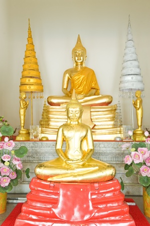 Two buddha statue in temple  photo