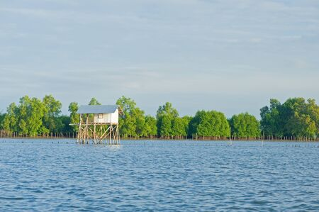 Fishing house near river mounth photo