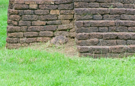 Old brick wall on grass photo