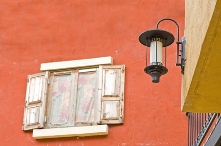 Lamp and Vintage window on orange cement wall can be used for background photo