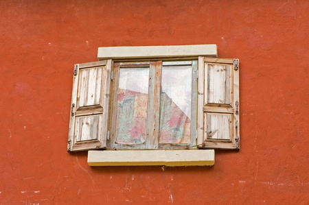 Vintage window on orange cement wall can be used for background photo