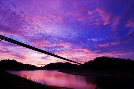 Sunset in Kangkrajan dam with rope bridge