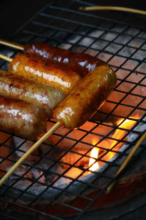 parch: Grilled sausage on stove Stock Photo