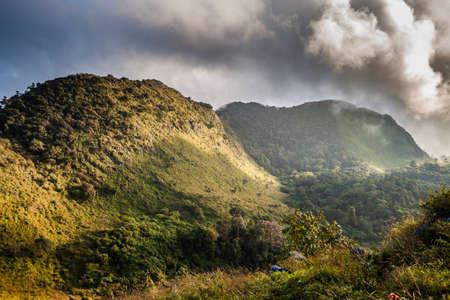 sky cloud: mountain peak and raining fog blue sky Stock Photo