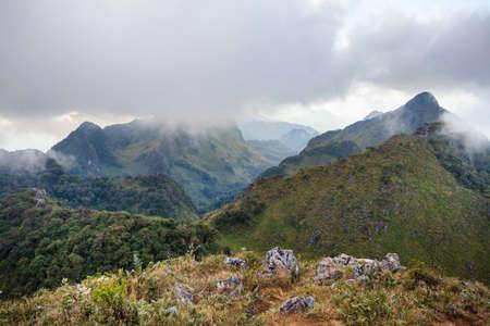 mountain peak and raining fog blue sky