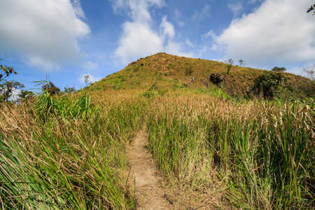salient: trails on the mountain peak  and blue sky