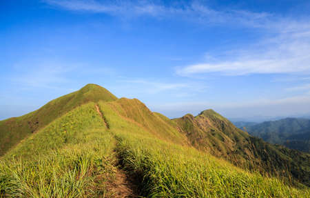 trails on the mountain peak  and blue sky
