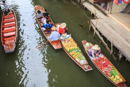 Ratchaburi, Thailand - February 26, 2012: Longtail boat with food and souvenir for sale in damnernsaduak floating market. This is a cultural heritage of Thailand. Activity of interest for tourists is take a boat visit the market along the river. And eat t