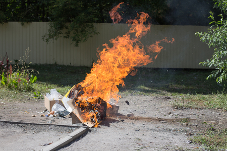 defilement: Illegal burning of waste in violation of environmental norms.