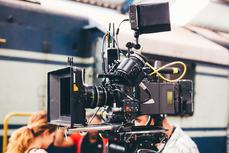 Behind the scenes of filming and video production is a professional camera outdoor, cinema equipment.