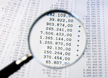 Magnifying glass focused on a large amounts billing