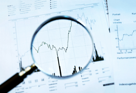 stock price: Magnifier focuses a chart with stock price