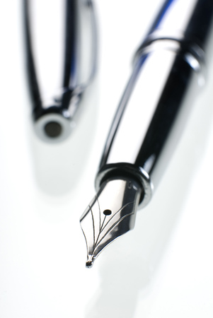 fountain pen writing: Close up of a silver fountain pen on white