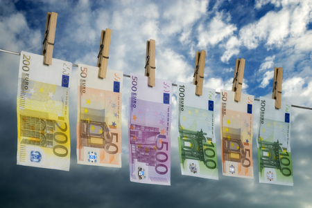 Euro bills hanging on a washing line, symbolizing money laundering