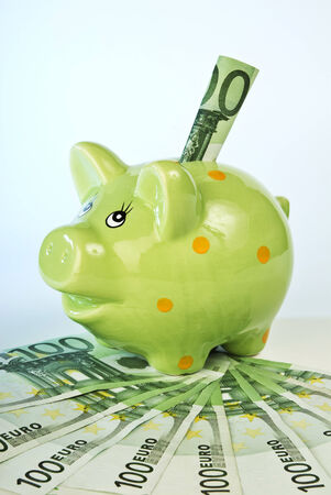 sham: Piggy bank with 100 Euro banknotes  Stock Photo