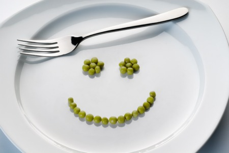Plate with peas forming a smiley