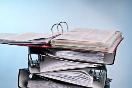 contractual: Open folder on a pile of other folders Stock Photo