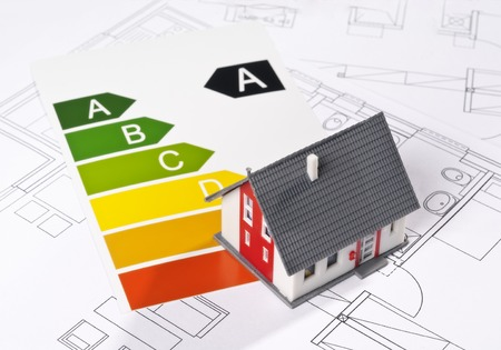Energy efficiency label with model and architecture blueprint photo
