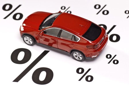 Car between percent signs as a symbol of discount Stock Photo
