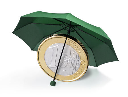 safe investment: Euro coin is protected by a green umbrella Stock Photo