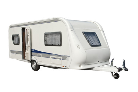 View of a modern caravan with open door