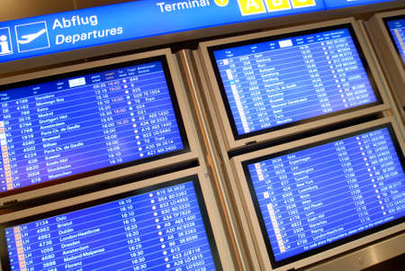 informing: Billboard with departures at the airport Stock Photo