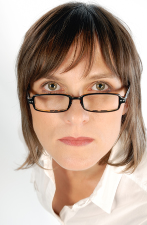 Businesswoman looking sternly over her glasses