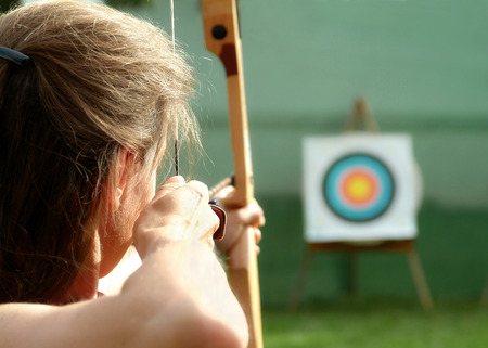 Archer spans the bow and aims to target