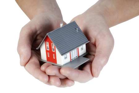 developers: Hands holding a house carefully Stock Photo