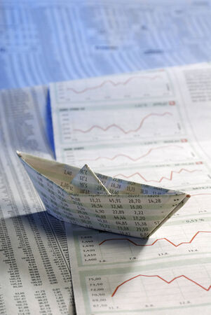 Paper ship on stock prices photo