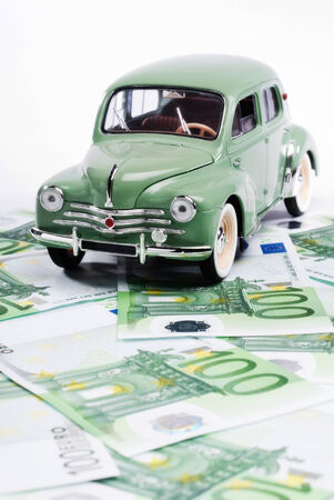 old fashioned car: Old car and a lot of money