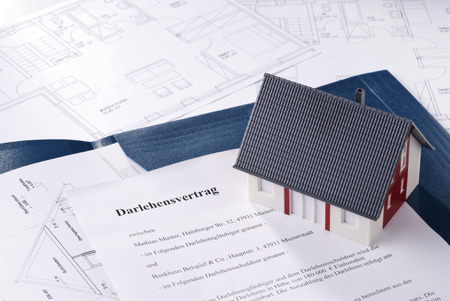 Home with loan agreement an blueprints