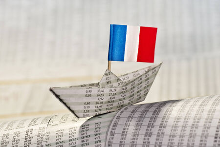 Paper boat with flag of France shipping on financial news  photo