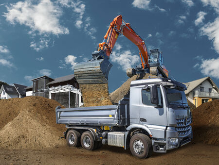Truck and excavator on a construction site at living site. photo