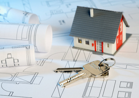 House with blueprints and keys Stockfoto